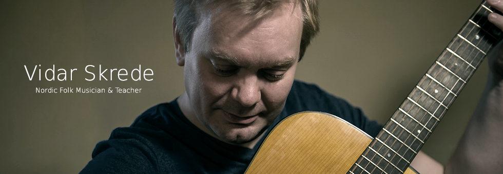Nordic folk musician Vidar Skrede plays guitar