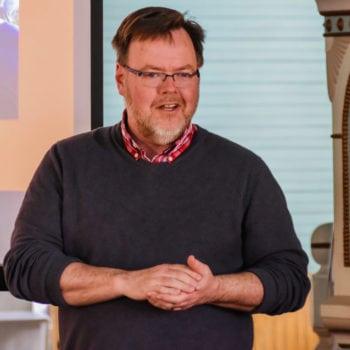 Chris Johnson, President/CEO of Vesterheim Norwegian-American Museum honors volunteers at a special volunteer event in 2018.