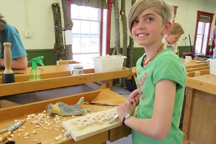 A student in Vesterheim's Whittling Klubb for Kids carving