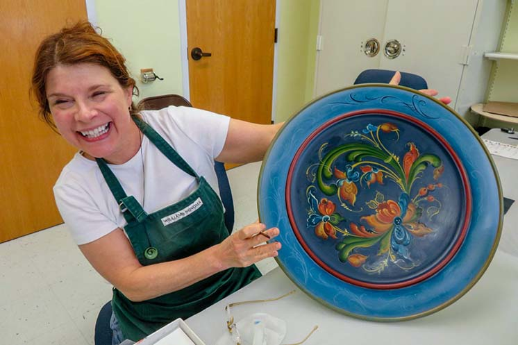 Rosemaling student shows her work in Vesterheim Folk Art School