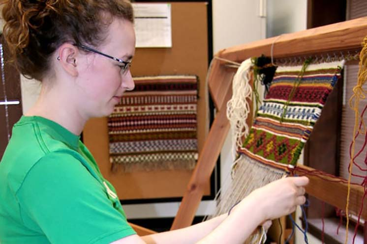 Student weaving in Vesterheim Folk Art School class