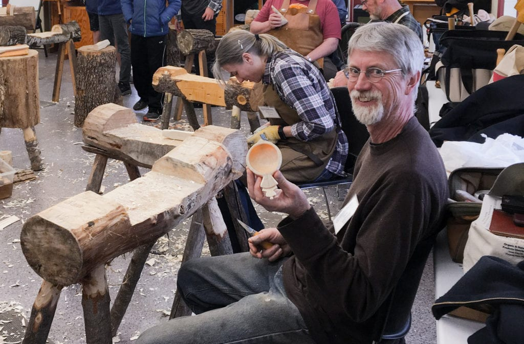 Woodworker Dale Kittleson holds up the kuksa bowl he's making in a Vesterheim Folk Art School class.