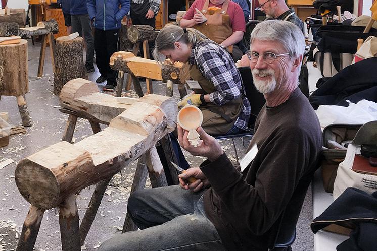 Woodworker Dale Kittleson holds up the kuksa bowl he's making in a Vesterheim Folk Art School class.