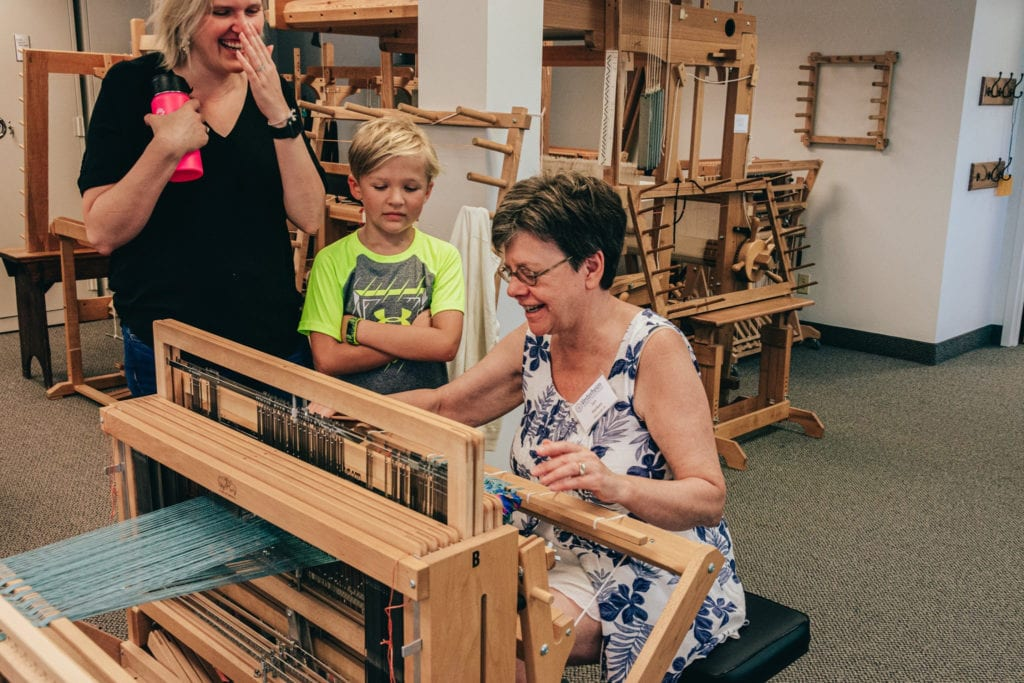 Jan Heikes works at the weaving loom in a Vesterheim Folk Art School class.