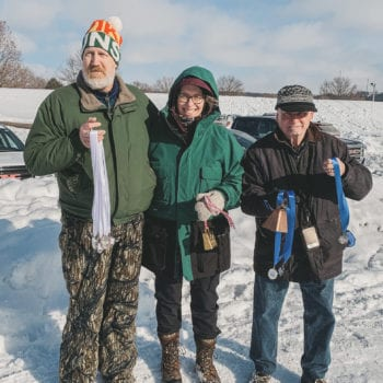 Volunteers award medals in the Decorah Prairie during Vesterheim and Sons of Norway Barneløpet Children's Ski Event.