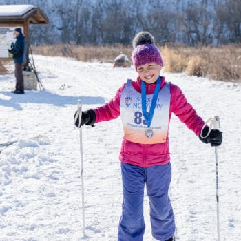 Families enjoy skiing in the Decorah Prairie during Vesterheim and Sons of Norway Barneløpet Children's Ski Event