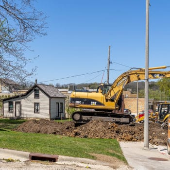 Construction work in Vesterheim's Heritage Park shows machinery and dirt work.