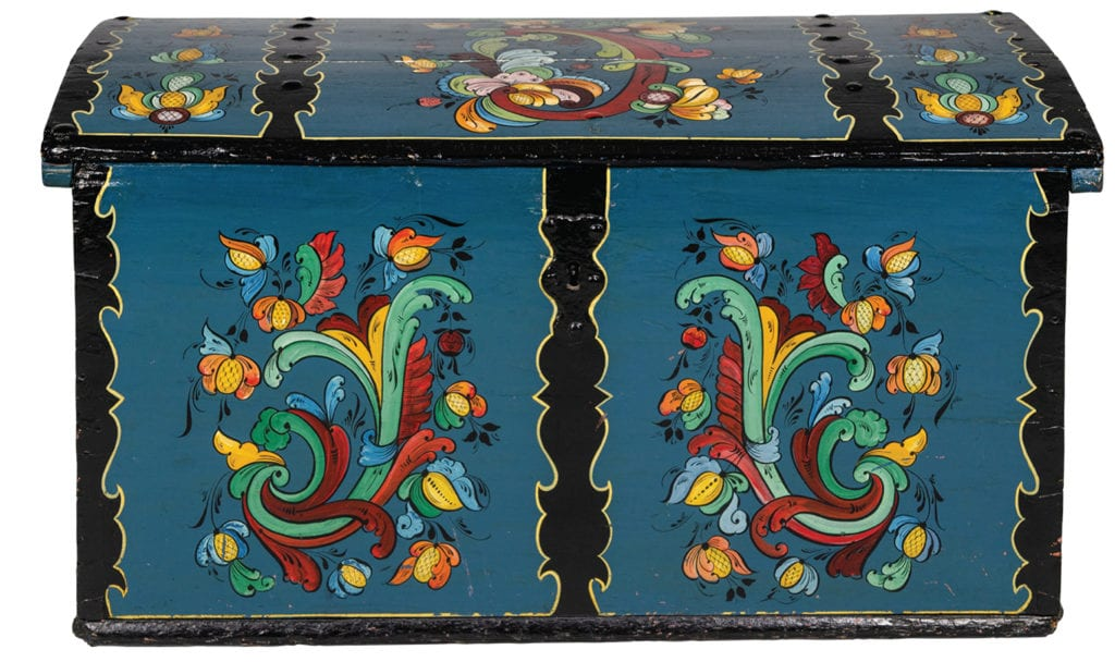 Wooden trunk painted by Per Lysne and carried from Norway to American by Herborg Tvedt. From Vesterheim collection.