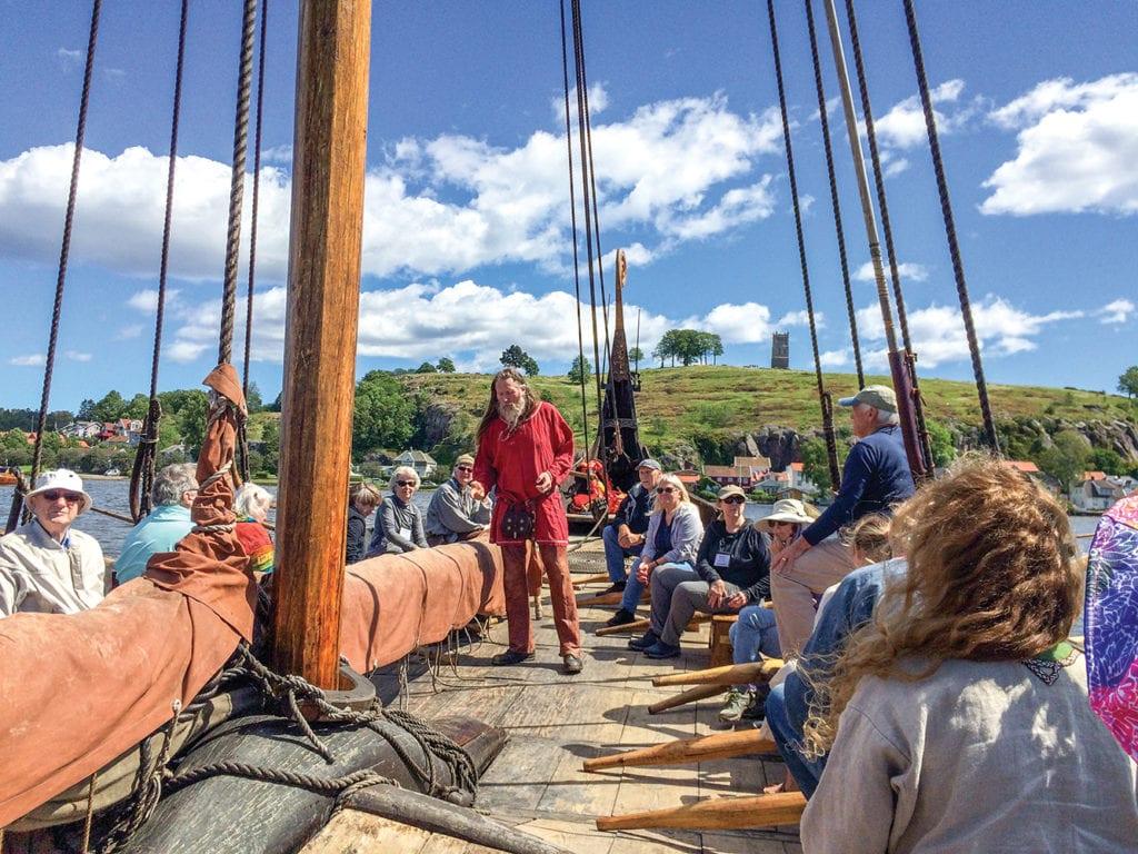 tour group rows Viking Ship on Vesterheim tour