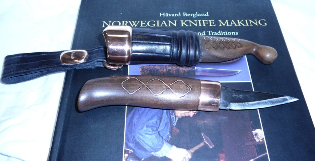 knife and sheath made by Paul Rochrbarcer with book by Håvard Bergland