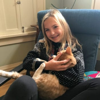Girl sitting with cat