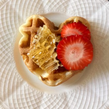 Plate with Norwegian heart waffle and strawberries